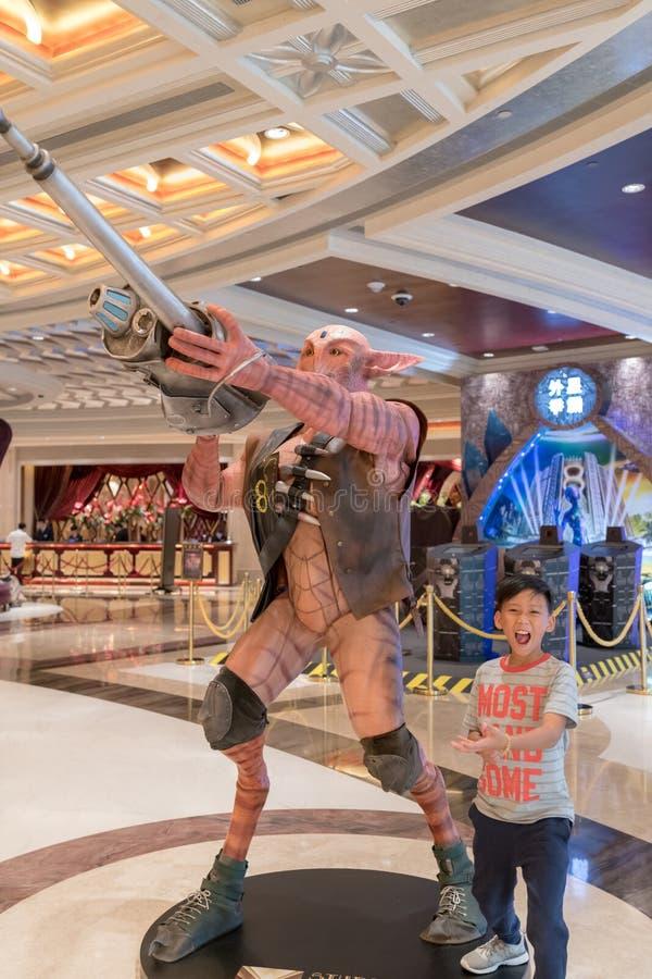 Monsters in the hotel lobby , studio city, macau, fun, indoors boy having fun stock images