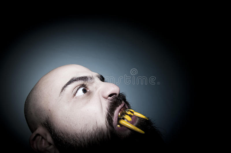 Download Monstrous Man With Long Teeth Stock Photo - Image of person, horizontal: 17287430