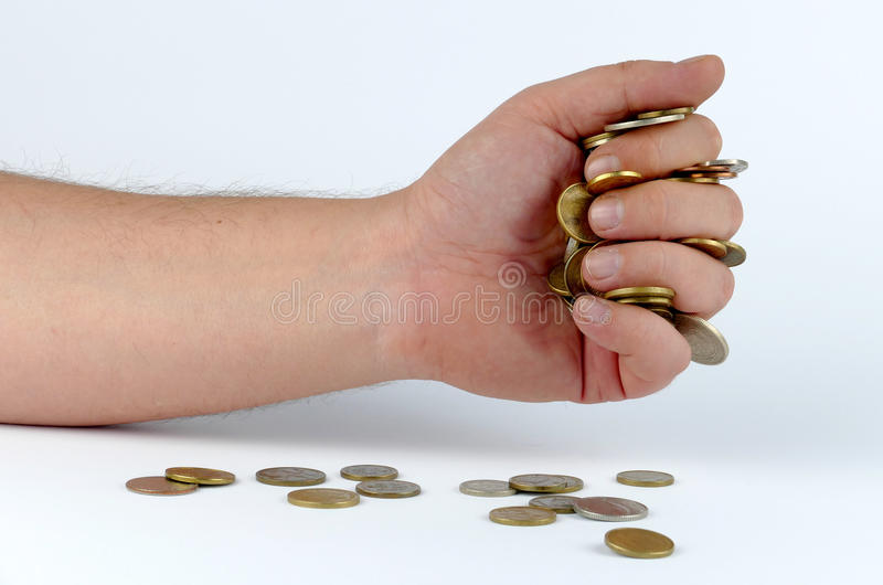 Montão das moedas na mão fotos de stock