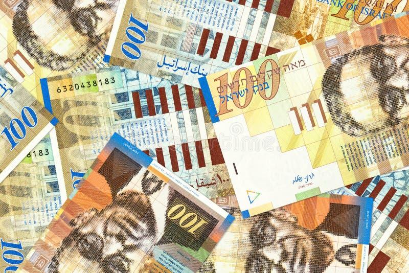 Montão de cédulas novas do shekel do israelita 100 imagens de stock royalty free