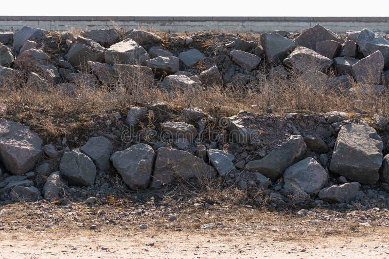 Mont?n del primer grande de las piedras del granito como fondo texturizado imagen de archivo