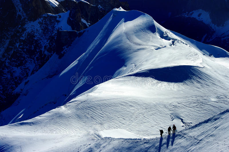 Mont blanc. A group of mountaineers climbing the Mont blanc royalty free stock photo