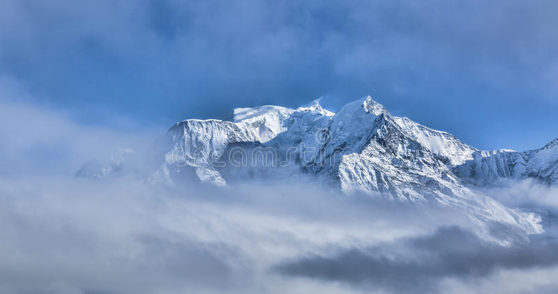 Mont Blanc. Above the clouds in winter stock images