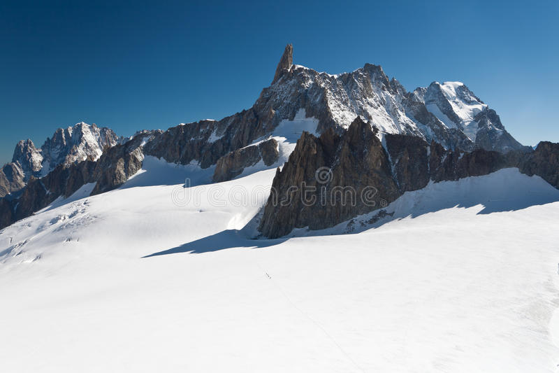 Mont Blanc - Dent du Geant. Summer view of Dent du Geant peak and glacier in Mont Blanc massif royalty free stock photography