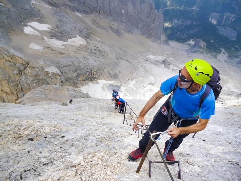 Mountaineering expedition ascending to the top stock images