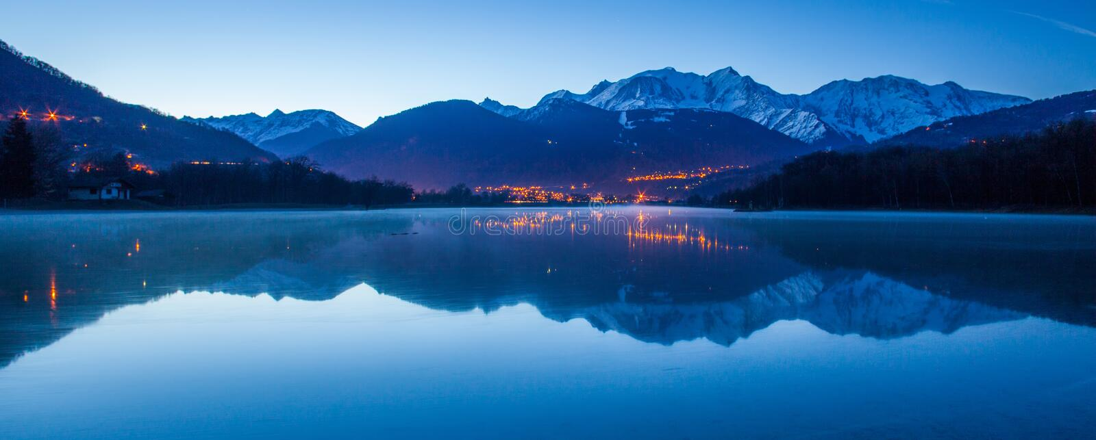 Mont Blanc Massif, France and Reflection I. Mont Blanc Massif and reflection captured from the edge of Lac du Passy, Passy, France. Located in the Arve Valley stock image