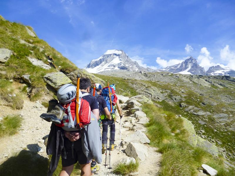 MONT BLANC, Mountaineering with backpacks on expedition to highest Alps peak royalty free stock images