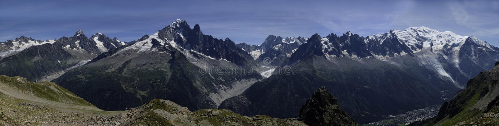 The Mont Blanc range. A panoramic view of the Mont Blanc range in Summer. France royalty free stock images