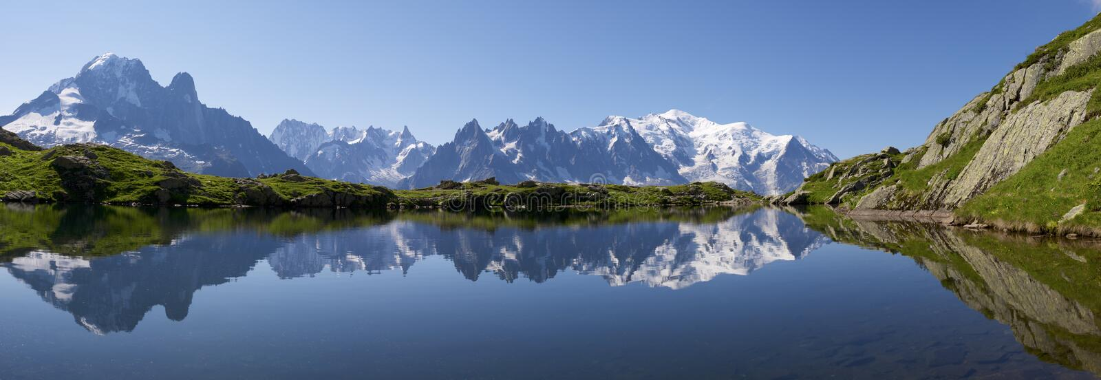 Mont Blanc. Reflected in Cheserys Lake,  Massif, Alps, France royalty free stock images
