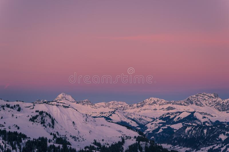 Mont Charvin left and the Aravis mountain range at sunrise or dawn, view from the top of Megève, Haute-Savoie, France stock photography