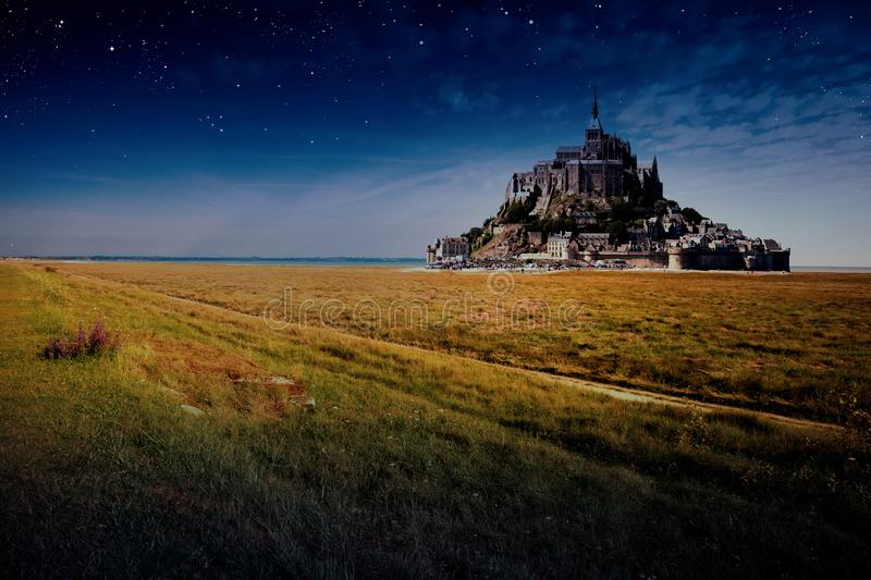 Mont Saint Michel abbey at night stock photos