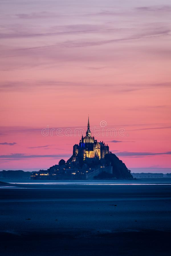 Mont Saint-Michel, France,after sunset. Mont Saint-Michel seen from across the bay just after sunset. as it was low tide, the island was not surrounded by the royalty free stock photo