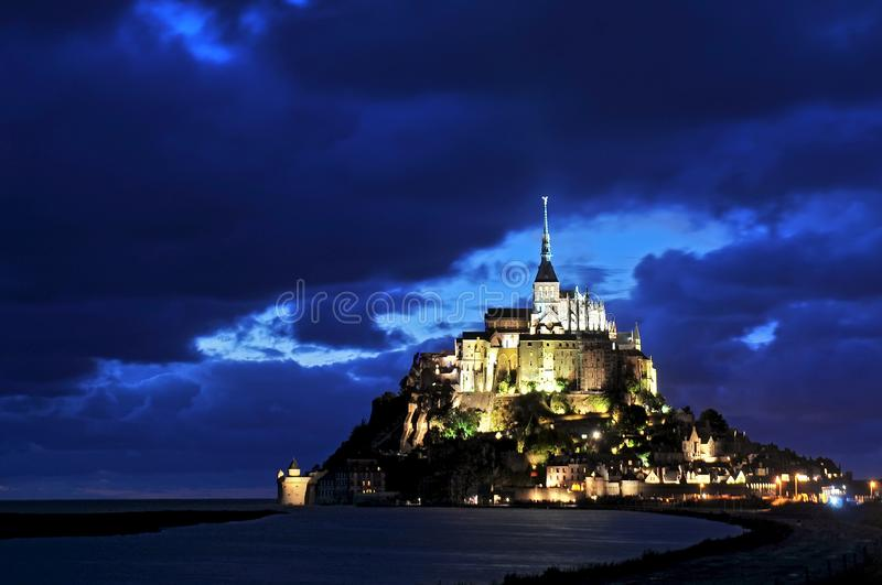 Mont St Michel illuminated at night. Normandy France royalty free stock photos