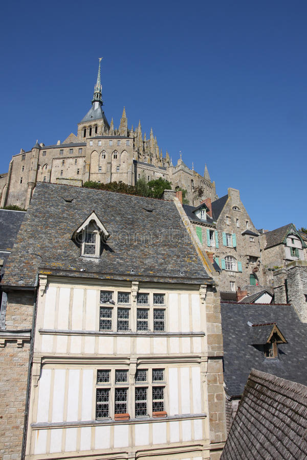 Mont St. Michel. Normandy, France. Mont St Michel from the lower ramparts looking up towards the spire stock photo