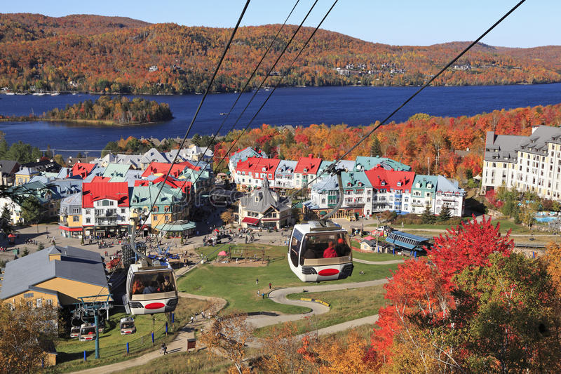 Mont Tremblant in autumn, Quebec, Canada. Mont, Lake and Village of Tremblant with autumn colors, Quebec, Canada royalty free stock photography