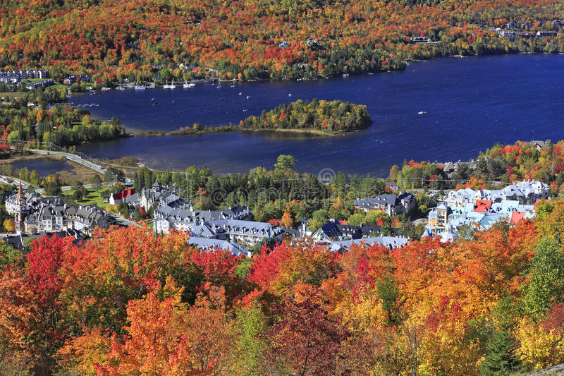 Mont Tremblant village and lake and autumn colors, Quebec, Canada. Mont Tremblant village and lake and autumn colors background, Quebec, Canada royalty free stock image