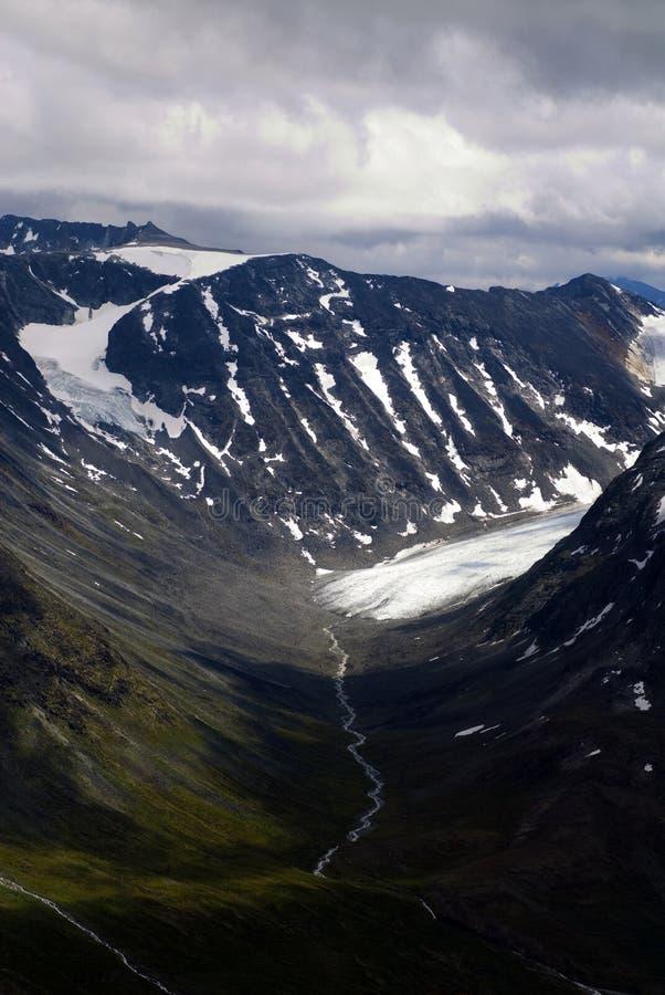 Montañas en Jotunheimen, glaciares de fusión fotos de archivo libres de regalías