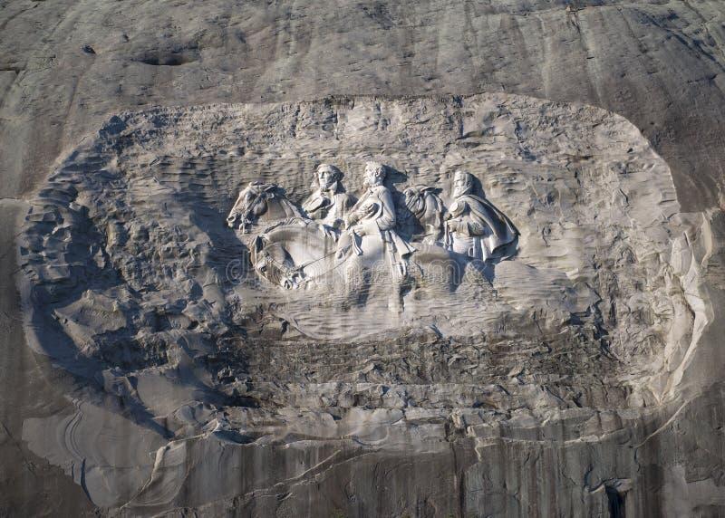 Montagna di pietra che scolpisce all'alba fotografia stock