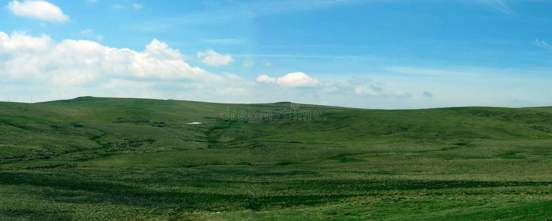 Montagnes vertes panoramiques image stock