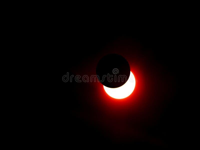 Montaje de la luna del eclipse solar imagenes de archivo