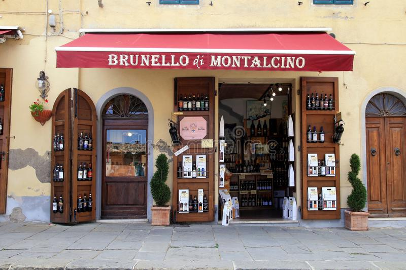 Traditional wine shop Brunello di Montalcino, Val d`Orcia, Tusca. MONTALCINO, ITALY - JULY 20, 2017: Entrance of traditional wine shop in Montalcino, Val d`Orcia stock photography