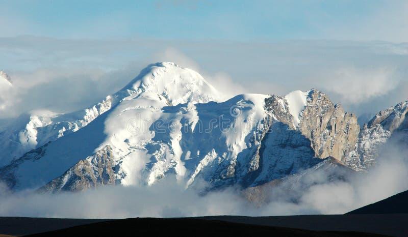 A montanha tibetana da neve fotografia de stock