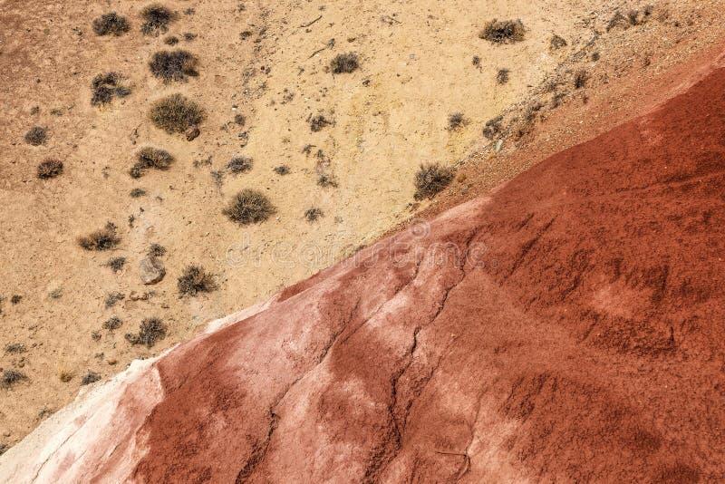 Montanhas coloridas da textura da rocha do fundo imagem de stock