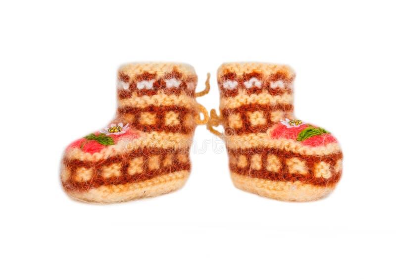 Montantes de lã feitos a mão do bebê, isolados no branco fotografia de stock royalty free