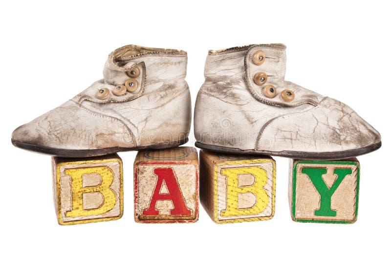Montantes do bebê em blocos do vintage imagens de stock royalty free