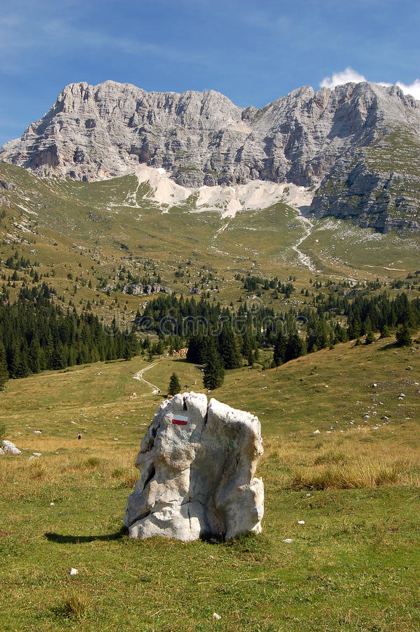 Montasio Plateau and Julian Alps. The high Plateau of Montasio with green pastures in summer and Julian Alps Jof di Montasio. Udine, Friuli Venezia Giulia, Italy royalty free stock photo