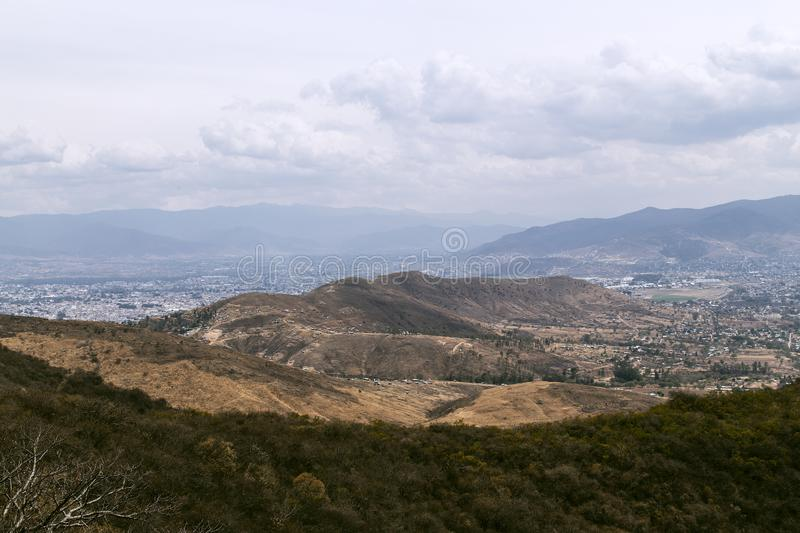 From Monte Alban view over the lower landscapes towards Las Rasas, local village in Oaxaca, Mexico. Monte Alban lights on a higher plateau in the landscape of stock photo