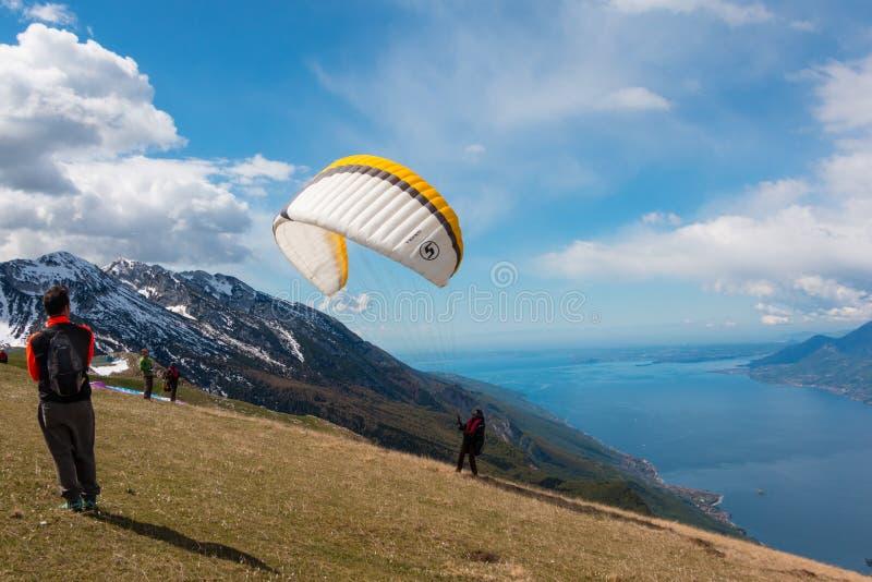 Monte Baldo. Paraglider at Monte Baldo, Lake Garda, Italy. Monte Baldo is a mountain range in the Italian Alps royalty free stock photo