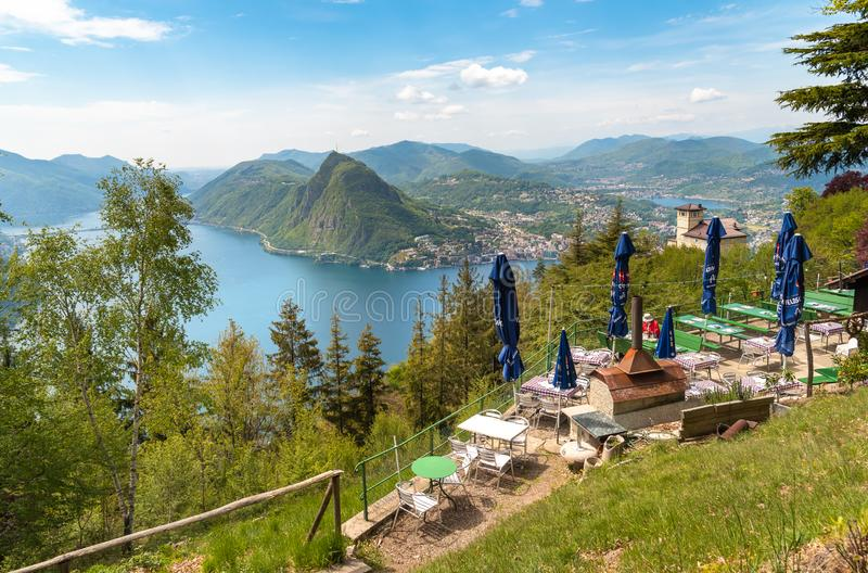 View of lake Lugano with Monte San Salvatore from a restaurant in Monte Bre, Switzerland stock image