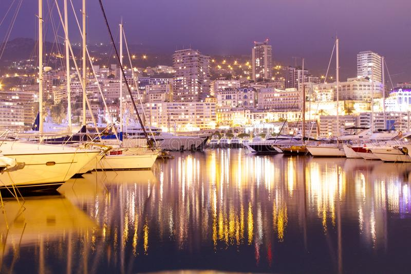 Monte Carlo harbour. The playground of the rich and famous. The harbour plays host to huge yachts and cruise ships docking in Monaco royalty free stock photo