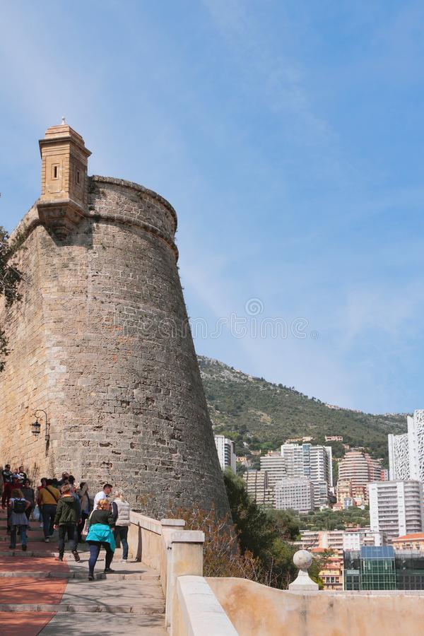 Monte Carlo, Monaco - Apr 19, 2019: Fortress and city on hillside. Fortress and city on hillside. Monte Carlo, Monaco - Apr 19, 2019 royalty free stock photography