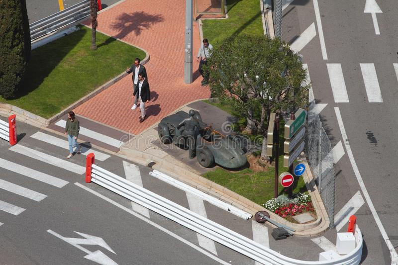 Monte Carlo, Monaco - Apr 19, 2019: Monument to racing driver at intersection of city streets. Monument to racing driver at intersection of city streets - Monte stock photography