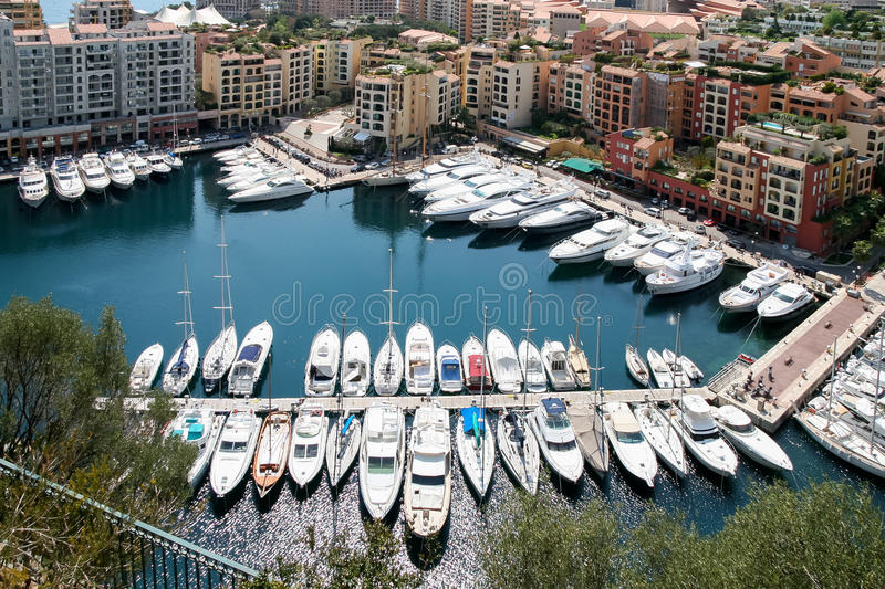 MONTE CARLO, MONACO - APRIL 19 : An assortment of boats and yachts in a marina at Monte Carlo Monaco on April 19, 2006 royalty free stock photo