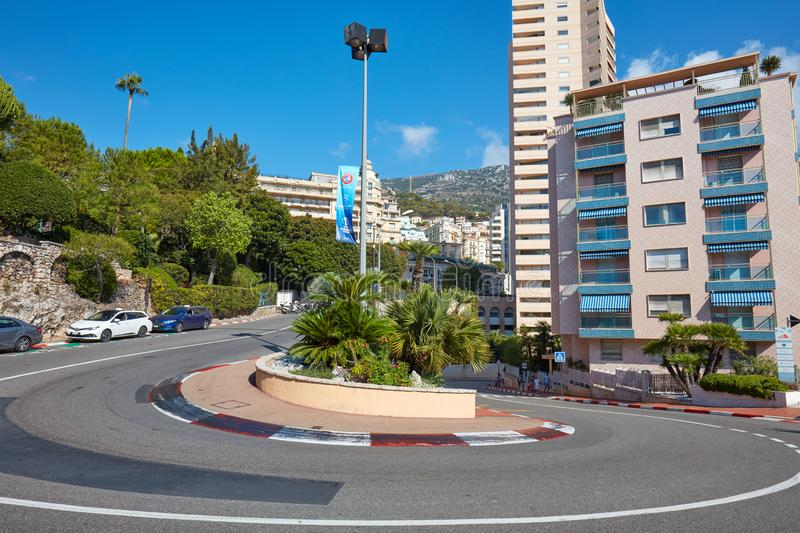 Monte Carlo empty street curve with formula one red and white signs in a sunny day in Monte Carlo. MONTE CARLO, MONACO - AUGUST 21, 2016: Monte Carlo empty royalty free stock image