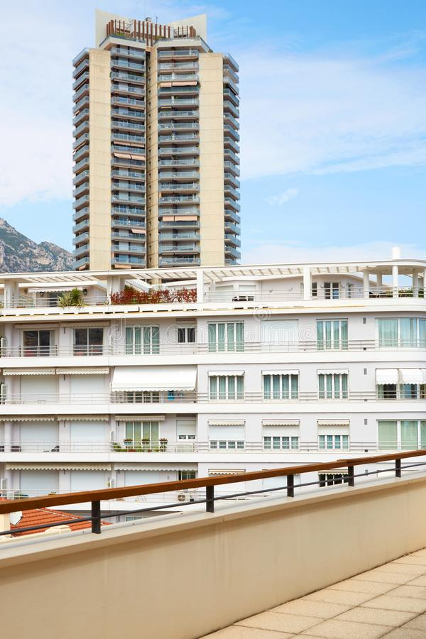 Monte Carlo terrace with white building and skyscraper view in a summer day in Monaco. MONTE CARLO, MONACO - AUGUST 20, 2016: Monte Carlo terrace with white royalty free stock images