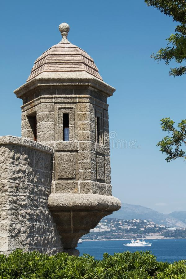 Monte Carlo palace wall with watch tower. Overlooking the Mediterranean ocean stock images