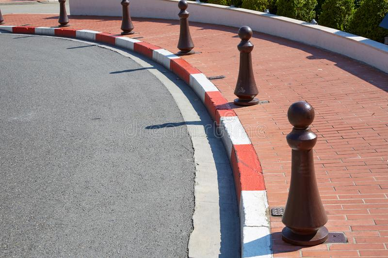 Monte Carlo street curve with formula one red and white signs detail in a summer day in Monte Carlo, Monaco. Monte Carlo street curve with formula one red and stock photo