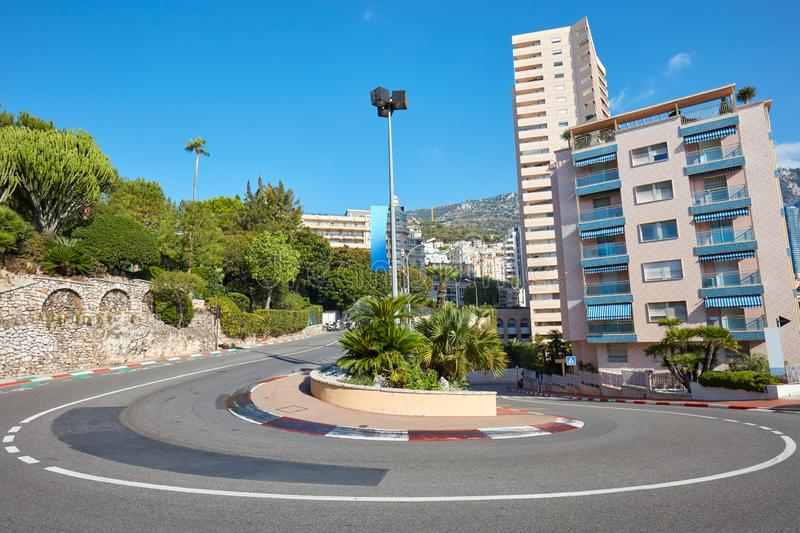 Monte Carlo street curve with formula one red and white signs in a sunny summer day in Monte Carlo, Monaco. Monte Carlo street curve with formula one red and stock photos