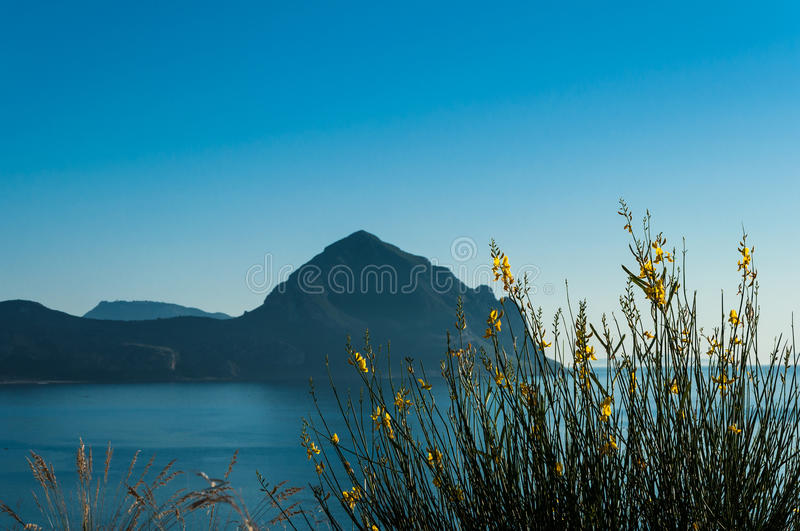 Monte Cofano. Mountain on the beach in Sicily stock photography