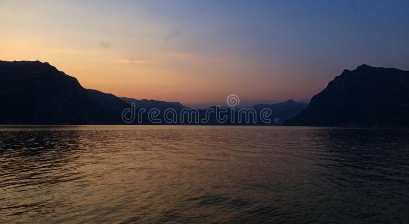 Coral July summer sunsetson Monte Isola stock photo