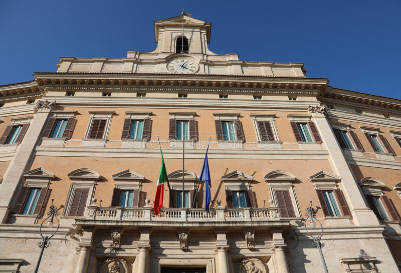 Montecitorio Palace in Rome Headquarters of the Italian Parliame. Montecitorio Palace in Rome Italy Headquarters of the Italian Parliament with flags royalty free stock photos