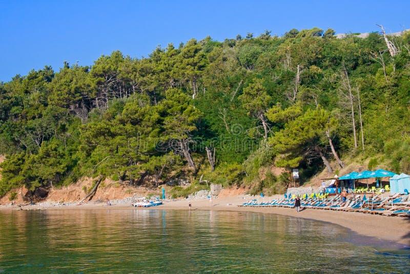 MONTENEGRO, BUDVA - JULY 12, 2015: Tourists on famous Mogren beach near Budva in Montenegro royalty free stock photos