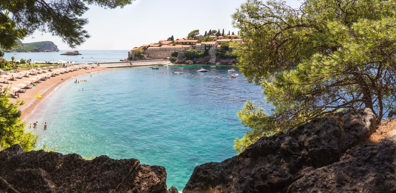 Panorama overlooking the island of St. Stephen, elite beach and the bay with turquoise water. MONTENEGRO, BUDVA, SVETI-STEFAN, 02 August 2014: Panorama royalty free stock photography
