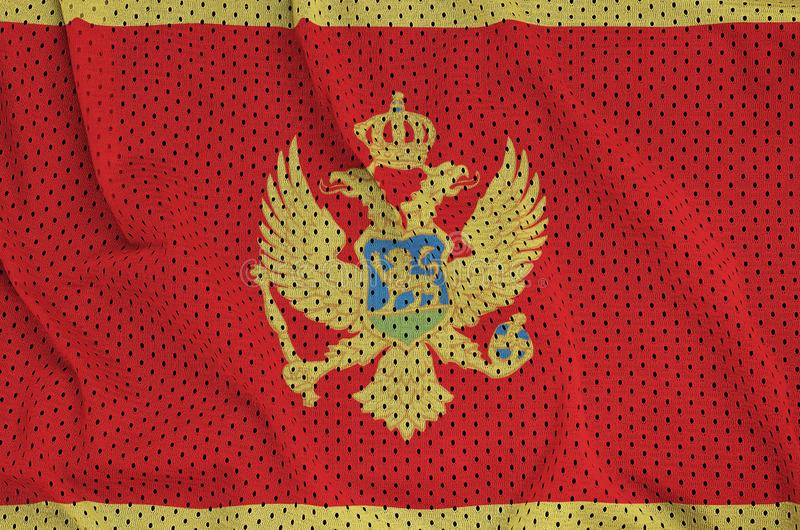 Montenegro flagga som skrivs ut på ett fab ingrepp för polyesternylonsportswear arkivfoto
