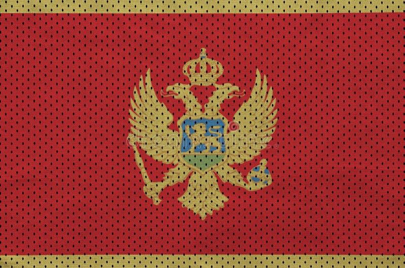 Montenegro flagga som skrivs ut på ett fab ingrepp för polyesternylonsportswear royaltyfri bild