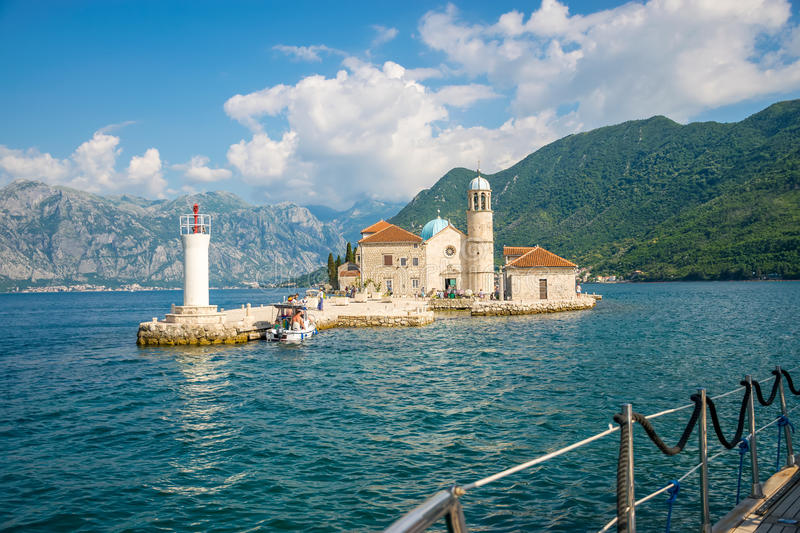Tourists sailed on a yacht to the island of Gospa od Skrpela in the Boka Bay of Kotor. stock images